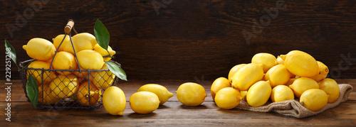 fresh lemons in a basket on wooden table