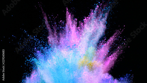 Multi-color powder explosion on black background Fototapeta