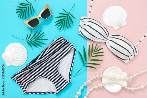 Summer holidays flat lay on blue and pink background Canvas Print