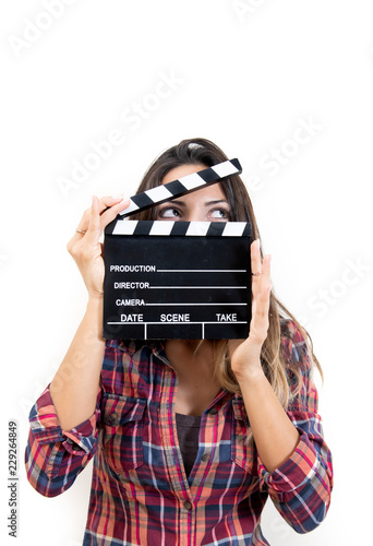 Fotografie, Tablou  Smiling woman face covered holding film slate waist up looking right