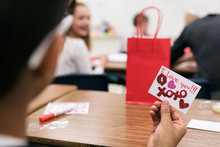 Classroom: Boy Holds Valentine For Girl