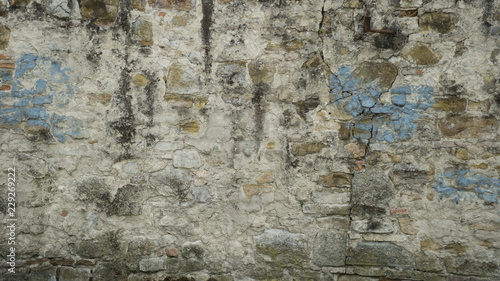 Foto auf AluDibond Alte schmutzig texturierte wand Background of weathered brick wall with cracks and peeling plaster