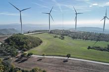 Landscape Of Rural Wind Farm In Sunlight