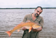 Fisherman With A Big Catch - G...