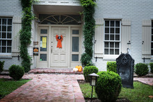 The House Is Decorated For Halloween: Pumpkins, On The Door Cast, The Inscription And Grave Pita. Evening, Houston, Texas, United States