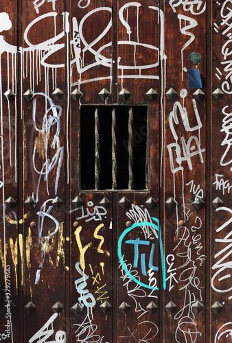 Wooden doorway in graffiti