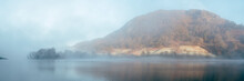 Fog On A Lake At Sunrise. Rydal Water, Cumbria, UK.