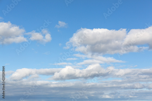 Fotografie, Obraz  Blue sky with several scattered cumulus clouds.