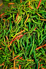 Close Up Of A Pile Of Spicy Red And Green Peppers At A Night Market
