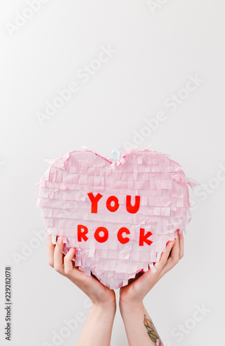 cute pastel paper party heart valentine pinata behind a white wall