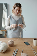 Woman With Knitting Needles