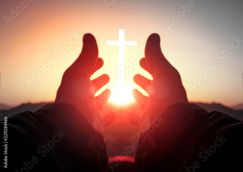 The concept of worship and praise: reaching for the cross Fototapete