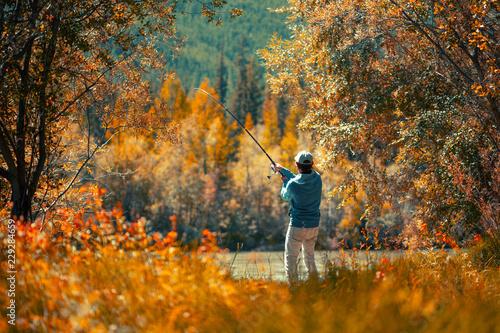 Amateur angler fishing on the autumn river Tableau sur Toile