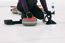 Curling: Woman Ready To Push Off From Hack