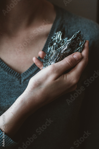 Woman holding gemstone on her hand
