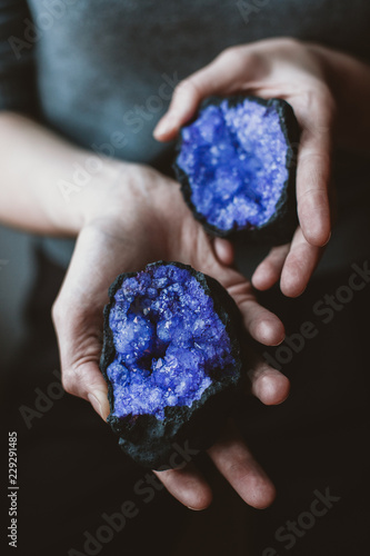 Woman holding purple gemstones in her hands