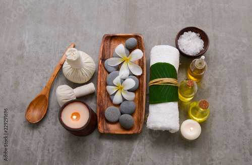Massage background with rolled towel, spa balls