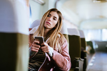 Young Woman Using Phone Travel...