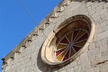 Red And Yellow Round Window