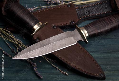 Obraz na plátne Damascus hunting knives with leather sheath on a vintage wooden background