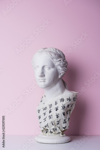 marble statue of woman with calligraphy