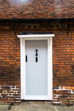 White Door On Red Brick