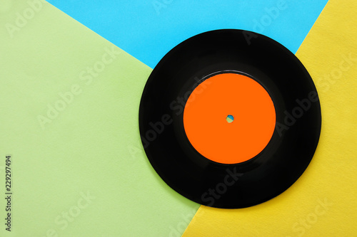 Photographie  Retro record over pastel yellow and blue double color background
