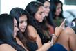 Teen Friends Using Their Phones