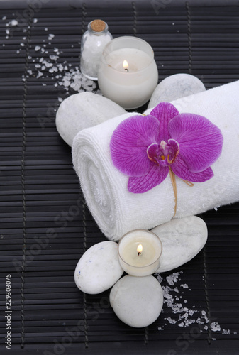 Keuken foto achterwand Spa Spa setting with candle, towel ,orchid, white stones, salt on mat