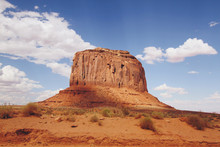 Sunrays Shining Down On Monument Valley's Characteristic, Iconic Butte Landscape.