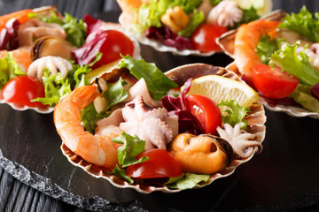Healthy snack salad of seafood shrimp, baby octopus, mussels and scallops are...