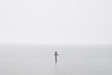 Groyne At High Tide On A Winters Day. Sheringham, Norfolk, UK.