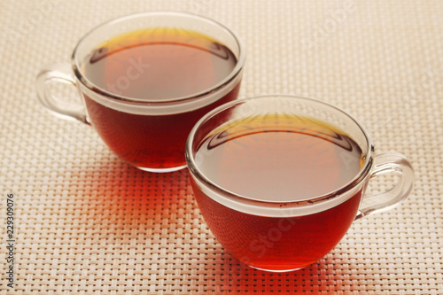 Foto op Aluminium Thee Two glass cups with black tea