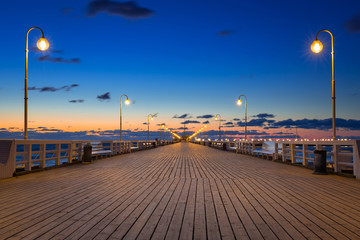 Fototapeta Molo Baltic sea pier in Sopot at sunrise, Poland