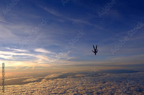 Foto op Plexiglas Volle maan Skydiving. Sunset jump.