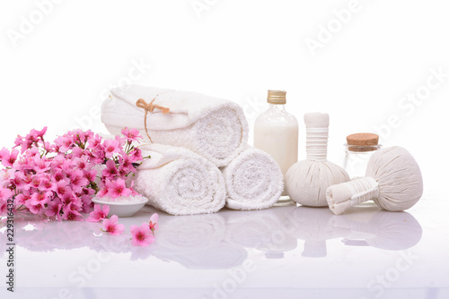 Tuinposter Spa spa setting with flower, towel, bottle oil