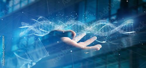 Obraz na płótnie Businessman holding a 3d render DNA