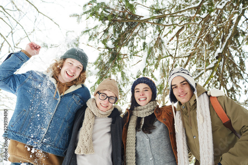Fotografie, Obraz  Low angle portrait of group of happy young people in winter resort posing under