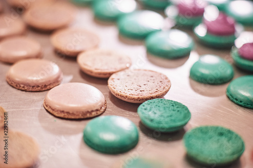 Montage in der Fensternische Macarons macaroons shells in a tray. Process of making macaron, french dessert,