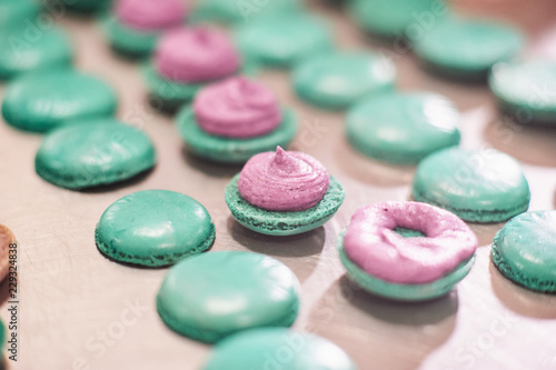 macaroons shells in a tray. Process of making macaron, french dessert,