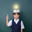 Asian chinese little girl wearing virtual reality helmet and pointing finger up to light bulb