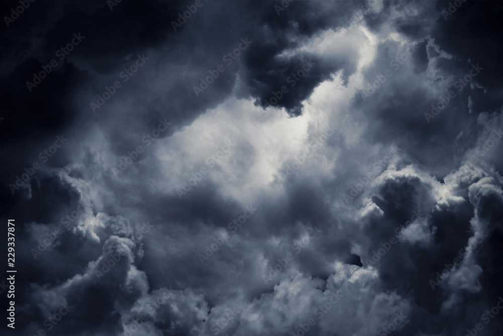 Fototapeta Dark moody storm clouds. Ominous warning.