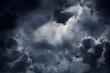 Leinwandbild Motiv Dark moody storm clouds. Ominous warning.