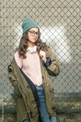 babdb0dd1076 Portrait of a stylish teenager hipster girl in a hat. Young fashionable  woman in a