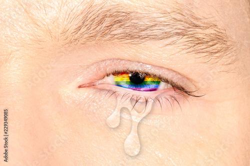 Fotografía  Crying eye with rainbow flag iris on color face
