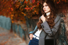 Outdoor Fashion Portrait Of Young Beautiful Fashionable Woman Wearing White Turtleneck, Grey Checked Blazer, Wrist Watch, Holding Small Leather Bag, Posing In Autumn Street. Copy, Empty Space For Text