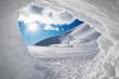 canvas print picture - Blick aus der Schneehöhle auf verschneite Winterlandschaft mit Sonne