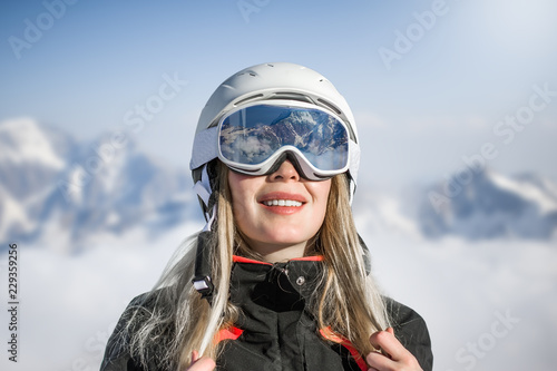 Young adult woman snowboarder or skier in snow