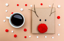 Christmas Gift Box With Coffee Cup On A Light Brown Paper Background