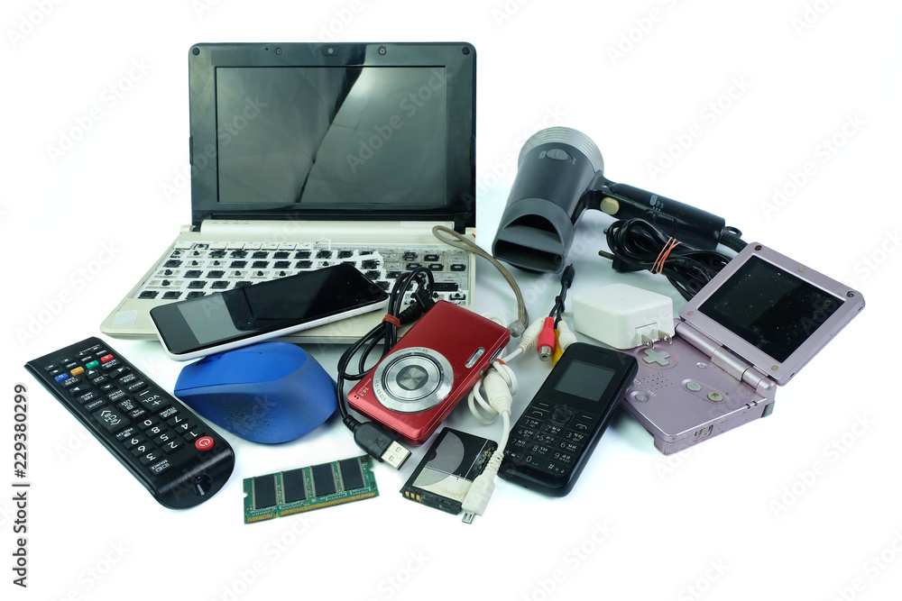 Fototapeta Electronic waste, gadgets for daily use and broken on white background
